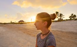 Girl at sunset caribbean beach in Mexico. Riviera Maya Royalty Free Stock Images