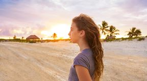 Girl at sunset caribbean beach in Mexico. Riviera Maya Stock Images