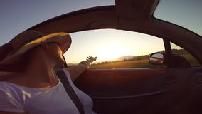 Girl at sunset in a convertible UK car stock footage