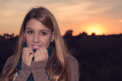 Girl at sunset. Portrait of the beautiful girl at sunset Royalty Free Stock Image