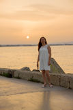 Girl sunset promenade Stock Photography
