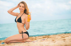 Girl with suntan lotion at the beach Stock Photography