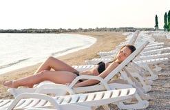 Girl suntanning. Stock Images