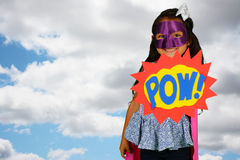 Girl Super Hero. Girl who is dressed up as a super hero royalty free stock photos