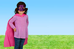 Girl Super Hero. Girl who is dressed up as a super hero royalty free stock photography