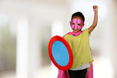 Girl Super Hero. Girl who is dressed up as a super hero royalty free stock image