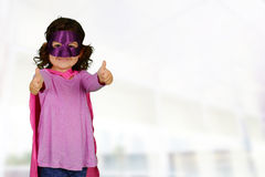 Girl Super Hero. Girl who is dressed up as a super hero royalty free stock images