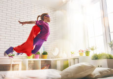Girl in Superhero's costume Stock Images