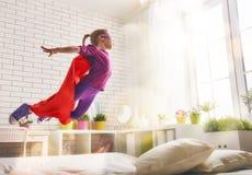 Girl in Superhero's costume Stock Images