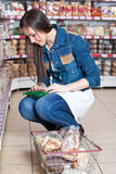 Girl  in supermarket Royalty Free Stock Image