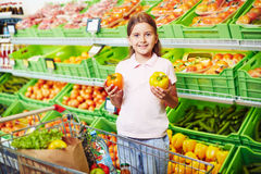 Girl in supermarket Stock Photography