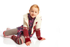 Girl Supports up with the poor from. Young girl sitting on the floor royalty free stock images
