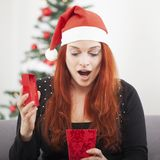 Girl is suprised open christmas present Stock Photography