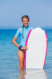 Girl with surf. Beautiful girl with surf board reading surfing Royalty Free Stock Photography