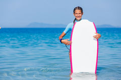 Girl with surf. Beautiful girl with surf board reading surfing Stock Photos