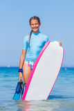 Girl with surf. Beautiful girl with surf board reading surfing Royalty Free Stock Image