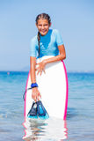 Girl with surf. Beautiful girl with surf board reading surfing Royalty Free Stock Photos