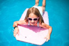 Girl on the surf board Royalty Free Stock Photo
