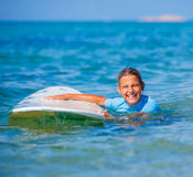Girl with surf Stock Image