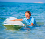 Girl with surf Stock Images