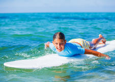 Girl with surf. Teenage girl in blue learning to surf Stock Photos