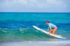 Girl with surf. Teenage girl in blue learning to surf Royalty Free Stock Photos