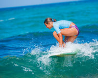 Girl with surf. Teenage girl in blue learning to surf Royalty Free Stock Images