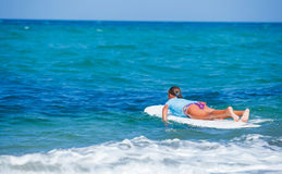 Girl with surf. Teenage girl in blue learning to surf Royalty Free Stock Image