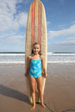Girl with surfboard Royalty Free Stock Photos
