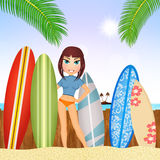 Girl with surfboard on the beach Royalty Free Stock Image