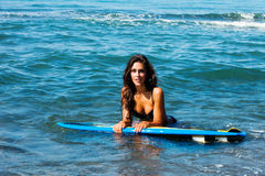 Girl with surfboard Royalty Free Stock Image