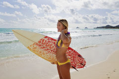 Girl with surfboard at kailua beach Royalty Free Stock Images
