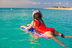girl on a surfboard in the turquoise sea Royalty Free Stock Photos