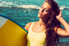 Girl with surfboard Royalty Free Stock Photography