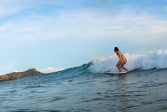 Girl Surfer. A bikini girl surfer in Hawaii stock images