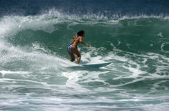 Girl surfer. A girl surfing at Ala Moana Bowls in Oahu, Hawaii Stock Photos