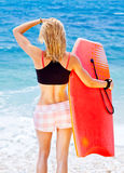 Girl surfer on the beach Royalty Free Stock Photos