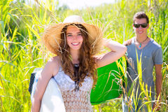 Girl surfer with beach hat walking with surfboard Stock Photo