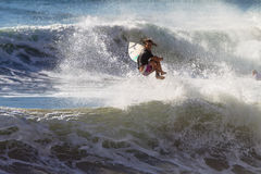 Girl Surfer Ejecting Wave Air. Sarah Baum surfing at Durban's new pier does a flying bail out on a morning wave at home. One of the talented surfing girls to Royalty Free Stock Photography