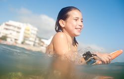Girl surfing Stock Photos