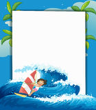 A girl surfing in front of a big empty signage Royalty Free Stock Photo