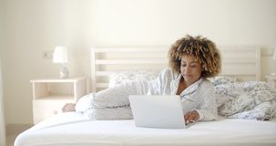 Girl Surfing On The Internet At Home