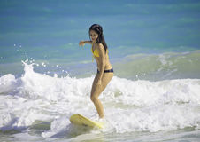Girl surfing at Kailua Beach Royalty Free Stock Image