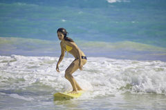Girl surfing at Kailua Beach Stock Image