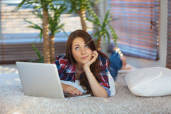 Girl surfing the net at home Royalty Free Stock Image