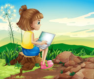 A girl surfing the net while sitting above a stump Royalty Free Stock Photos