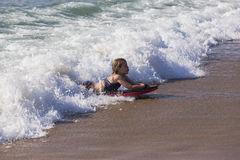 Girl Surfing Wave Beach royalty free stock photos