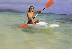 Girl with surfski Stock Photography