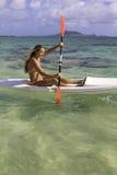 Girl with surfski Stock Photography