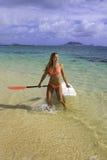 Girl with surfski Stock Photos